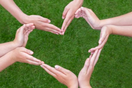 Diagnose_Kids_Finding-joy-after-childs-adhd-diagnosis_Article_8373_kids-hands-heart_ts_489736628-1